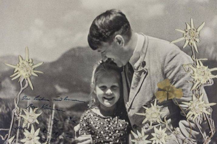 photograph of hitler embracing child of jewish grandmother auctioned for $11,000