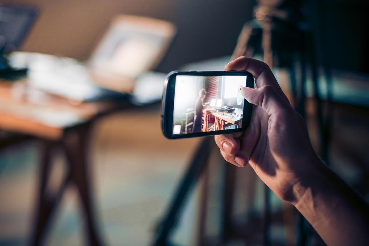 Image result for man capturing video in mobile