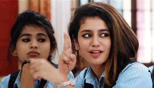 https://cdn.tamilspark.com/media/16323yjd-priya-prakash-varrier-expression-oru-adaar-love-film-actress-best-wallpaper-28759_1519127953.jpg