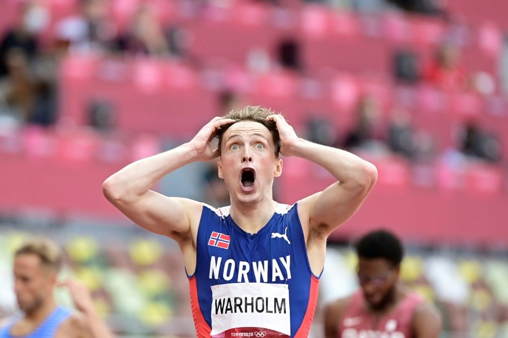 Norwegian athlete tearing his shirt in the excitement