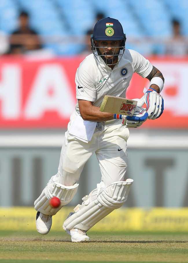 Virat Kohli struck a half-century to keep India moving ahead.