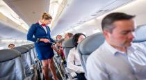 Funny air hostess was laying on flight