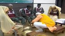 Modi washing employees legs