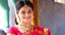 Actress Inthuja wearing saree