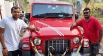 Natarajan given his signed t shirt to Mahindra car company