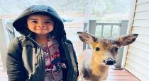 young-boy-with-baby-deer