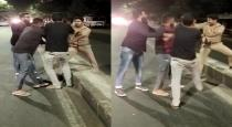 four men fight with single police