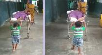 6 year old old boy pushing grandfather