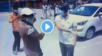 District collector slap a man on road viral video