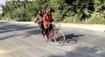 girl cycling with injuredd father in 1200 km